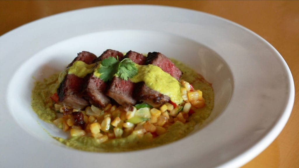 Sous Vide N.Y. strip over Sesame Corn Maque Choux with Roasted Corn Cilantro Sauce
